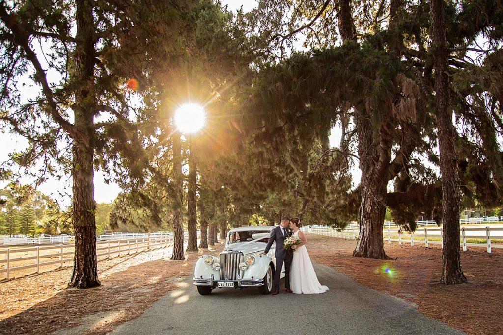 Perth Wedding Photographer Belvoir Homestead wedding Swan Valley Wedding Bride and Groom with wedding car