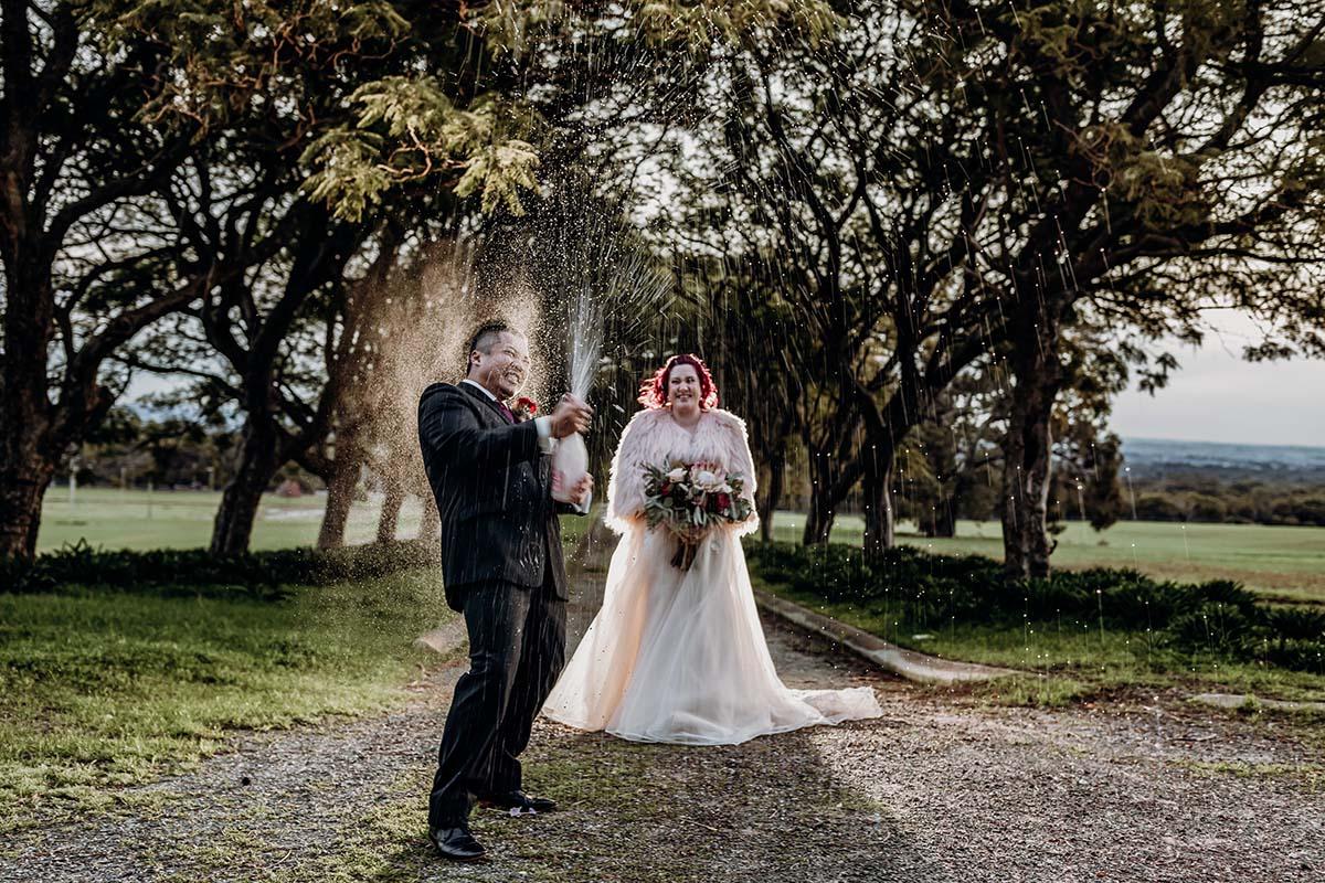 bride-groom-laneway-champagne-spray